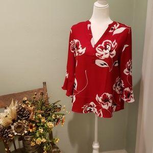 NWT women's bell sleeved blouse.